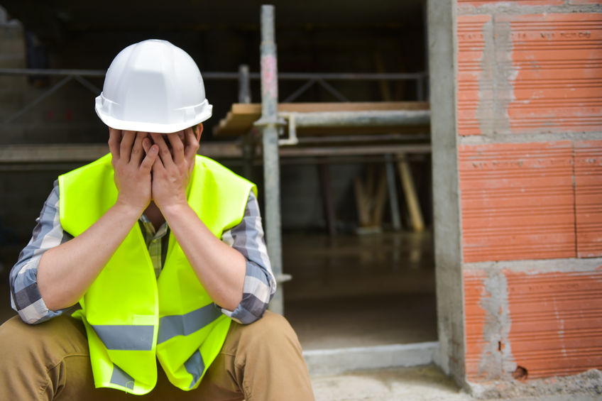 Construction Worker Covering His Face