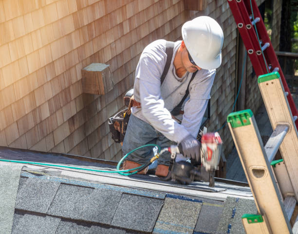 Roofer Installing New Roof Using A Nail Gun