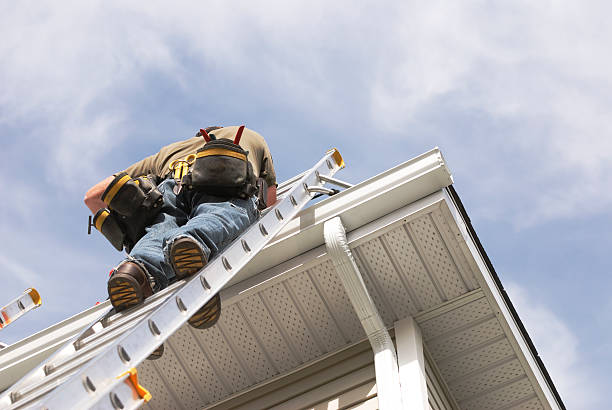 Man Climbing Up Ladder To Do Roof Repairs