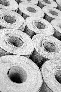 several rolls of grey roofing felt